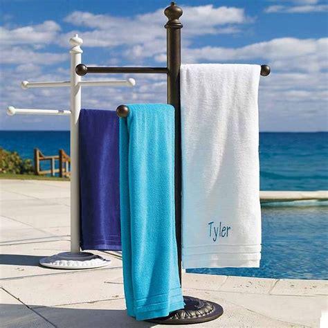 a bove pool towel rack of free standing towel rack