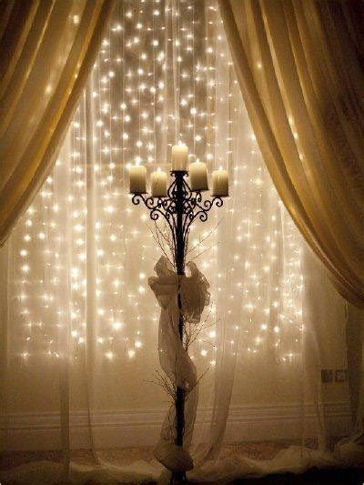 christmas lights on curtain rod behind sheer
