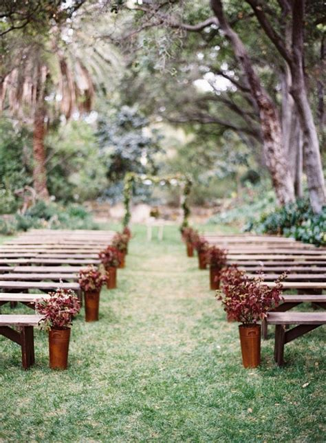Backyard Wedding Necessities Wooden Benches At An Outdoor Wedding Ceremony Wedding