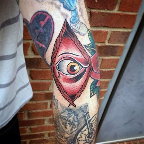 cartoon eye tattoo cartoon lie colored mystic crying eye tattoo on elbow