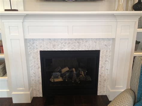 Glass Mosaic Fireplace Surround by White Stained Wooden Fireplace Mantel Above White Glass