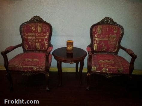 chair and coffee table made of sheesham wood in reasonable