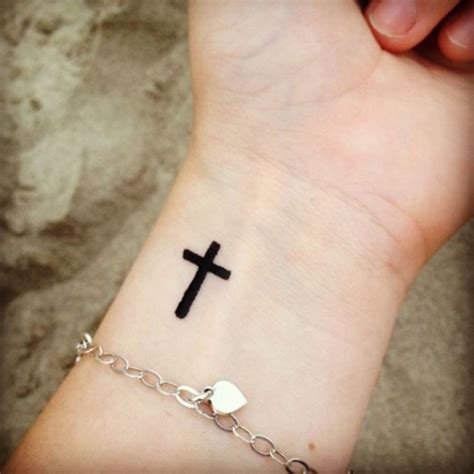 cross on wrist tattoo meaning cross tattoos on wrist designs ideas and meaning
