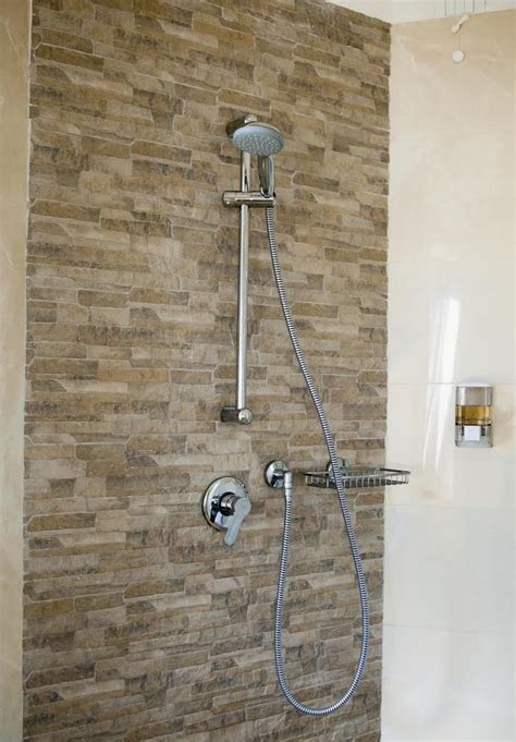 Shower Height Adjuster by A Guide To Shower Design