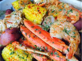 seafood boil jumbo shrimp crab legs sweet sausage corn on the cob and red potatoes its