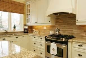 kitchen cabinets with backsplash ivory kitchen cabinets transitional kitchen brouwer design