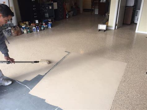 Painting garage floor with Rust Oleum EpoxyShield. Tan 2