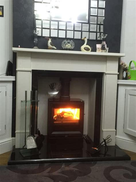stylish limestone and marble fireplace surrounds in