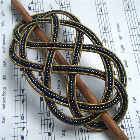 Three String Knot - navy and gold beaded guitar string barrette medium