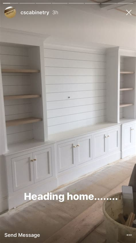 built in wall shelves with tv shiplap bookshelves next to the fireplace in living room