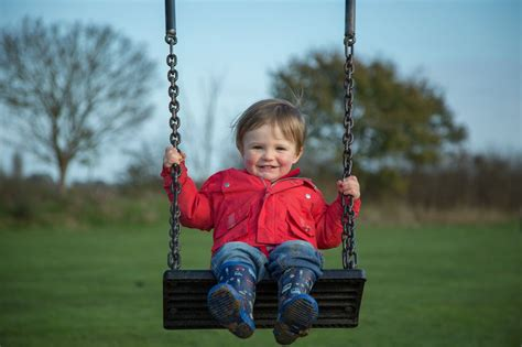 boy swing toddler on swing ed taylor
