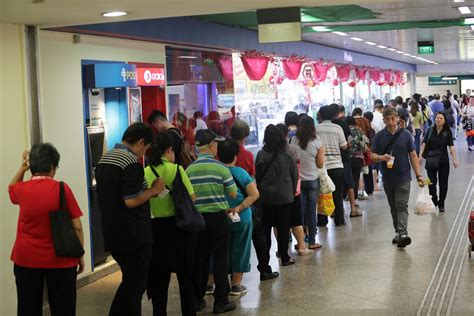 new year toto singapore queues for 9 7 million new year toto draw on jan 5