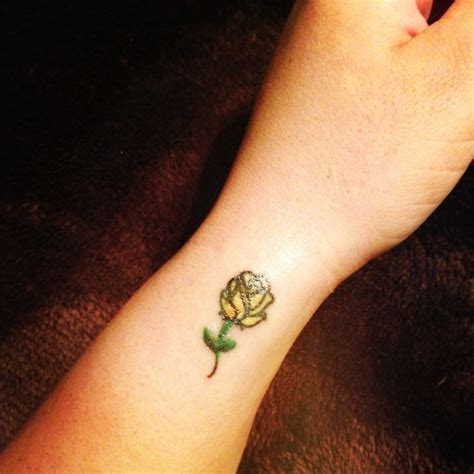 small roses tattoo small yellow loyalty