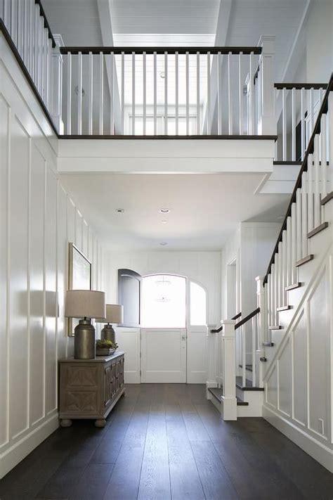 story foyer features full wall board  batten trim