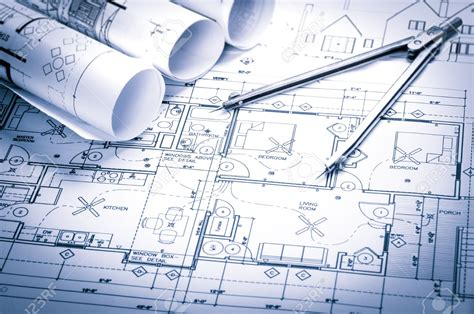 construction designs rolls of architecture blueprints and house plans
