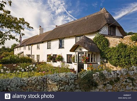 Shute Cottage by Thatched Cottage With Pretty Garden In The Of Shute Stock Photo Royalty Free