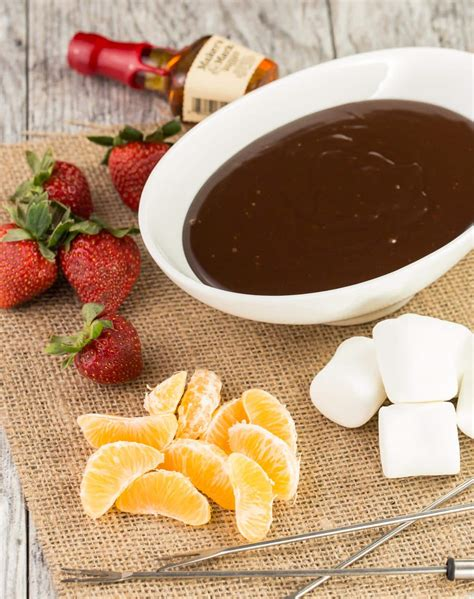 cocoa 40 basic to boozy recipes to celebrate national cocoa day books boozy cooker chocolate fondue garnish with lemon