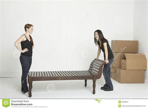how heavy are couches moving the heavy furniture royalty free stock images