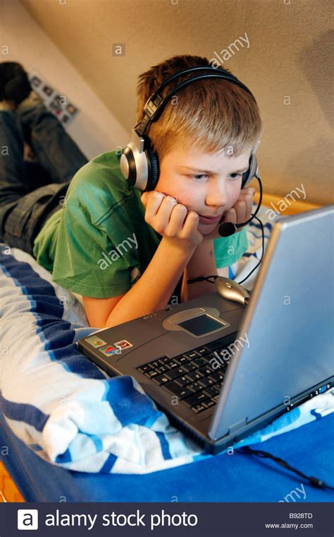 boy chat room a boy 13 years is chatting in his child room and talks to a stock photo royalty free