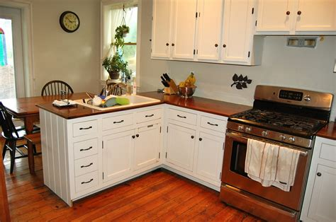 White Cabinets Wood Countertop by White Kitchen Interior With Wooden Countertop Interior