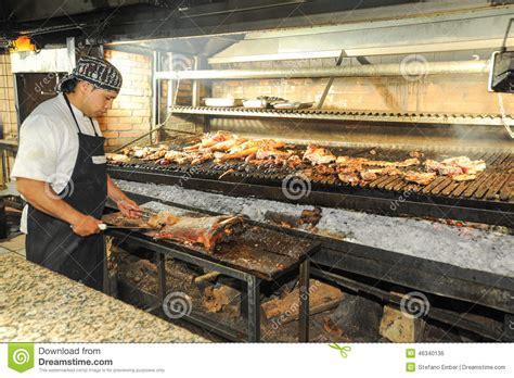 cook on the bbq grill at a restaurant of mendoza argentina editorial photo image 46340136