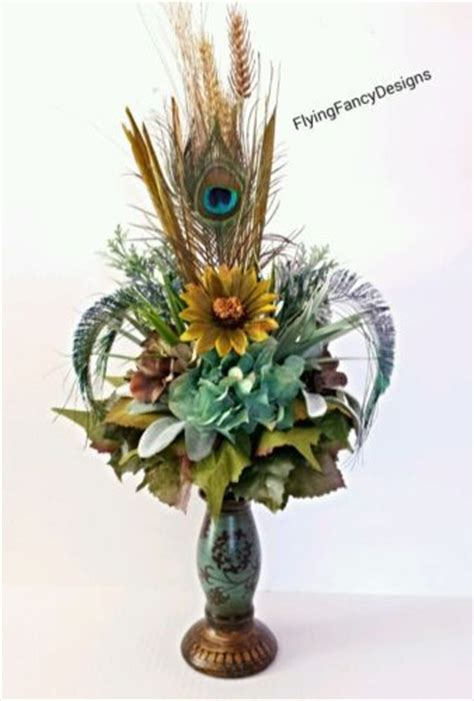 silk flower arrangement peacock feathers in home decor and 22 best images about floral arrangements on pinterest