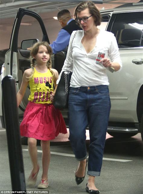 milla jovovich daughter milla jovovich displays her youthful complexion with