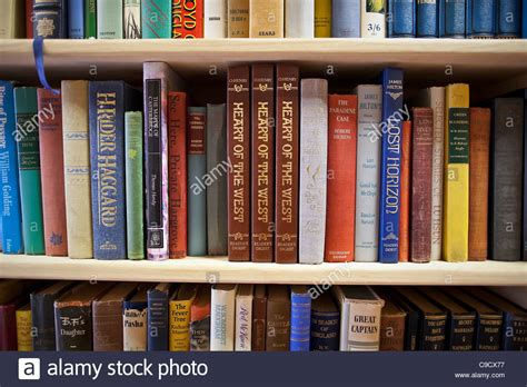 pictures of books on a shelf hardcover books on shelf in a used bookstore stock photo