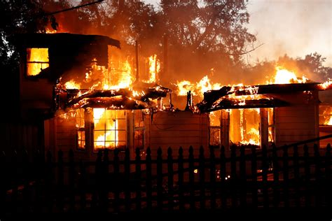 burnig house wildfire burns more than 175 homes businesses in