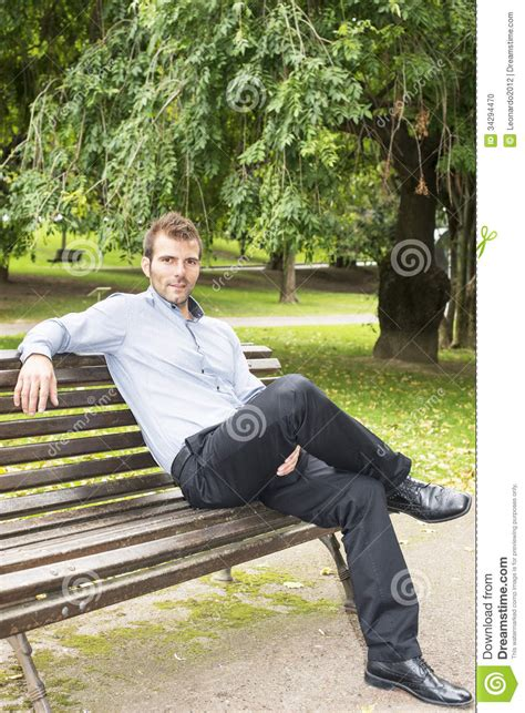 man on the bench man sitting and relaxing on a bench stock photo image
