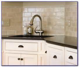 Beige subway tile backsplash with white cabinets tiles home design