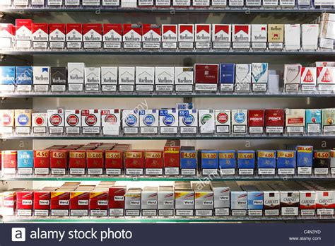cigarettes shelf in a store stock photo royalty free