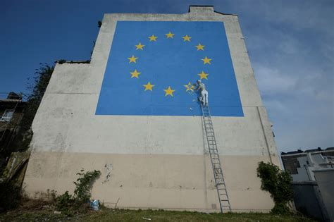 graffiti artist banksy joins brexit debate  mural