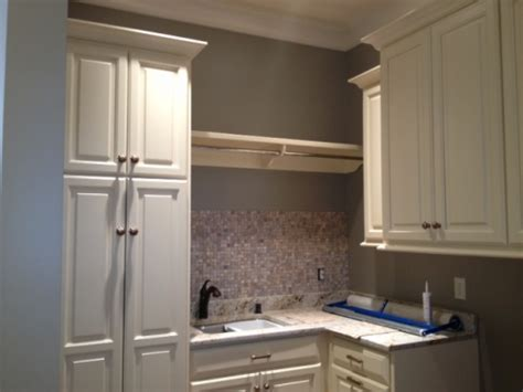 laundry room cabinets with hanging rod laundry room hanging bar home decoration ideas