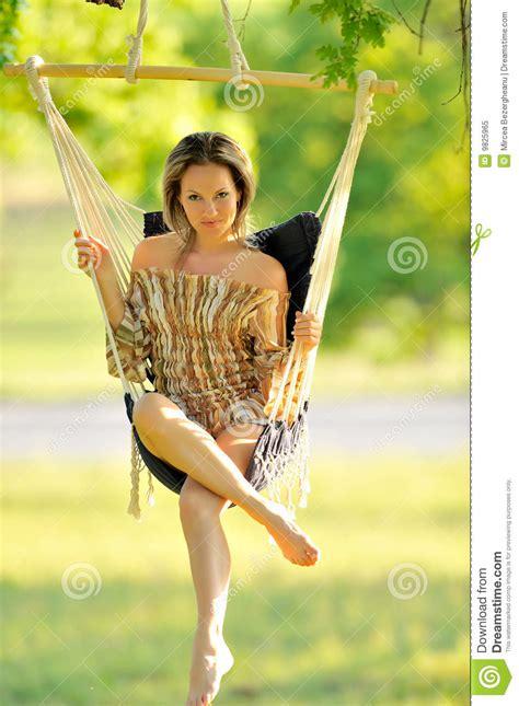 free swinging video beautiful young woman swinging royalty free stock photo