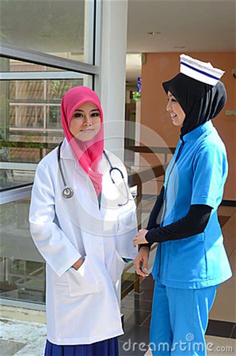 confident muslim doctor  nurse busy conversation
