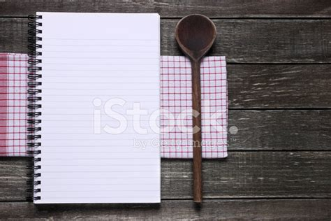 Notebook Wooden Table notebook and canvas on wooden table stock photos