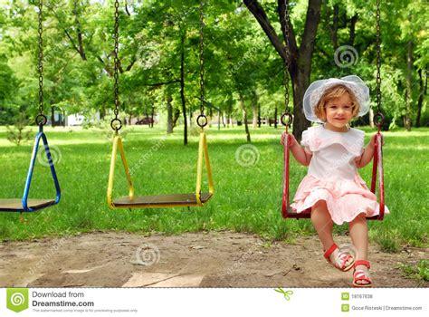 little swing little girl on swing royalty free stock photos image