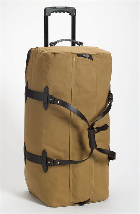 filson large wheeled duffle bag in beige for lyst