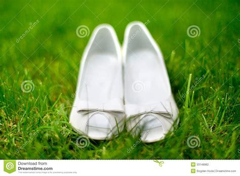 Elegant And Stylish, Modern Wedding Shoes Against Grass In