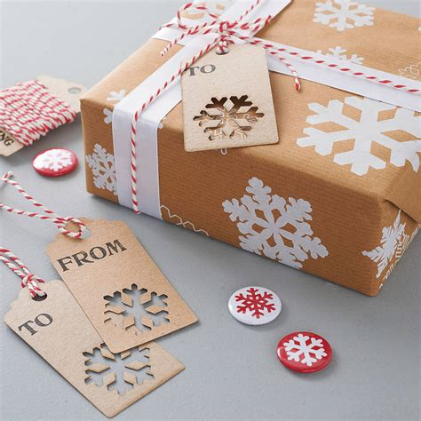 wrapping gifts recycled christmas snowflake gift wrap by sophia victoria