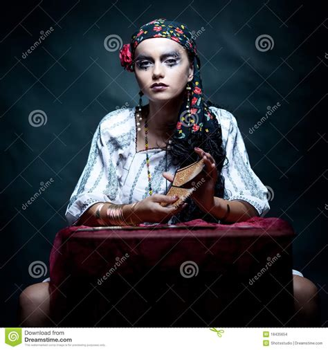 Modern Table Settings gypsy fortune teller mixing the tarot cards stock images