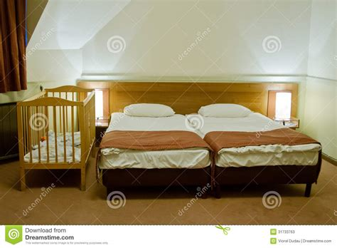 double toddler bed hotel room with baby cot stock image image of service