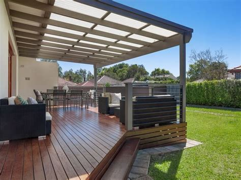 backyard deck prices deck with laserlight roofing above is perfect for