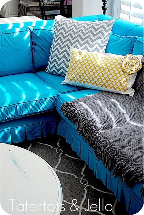 turquoise loveseat slipcover geometric pillow turquoise and ideas on pinterest