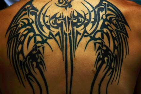 tribal wings tattoos on back