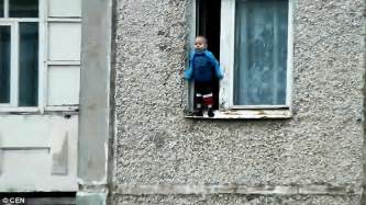 Window With Ledge Russian Toddler Balances On The Ledge Of An Eighth Floor