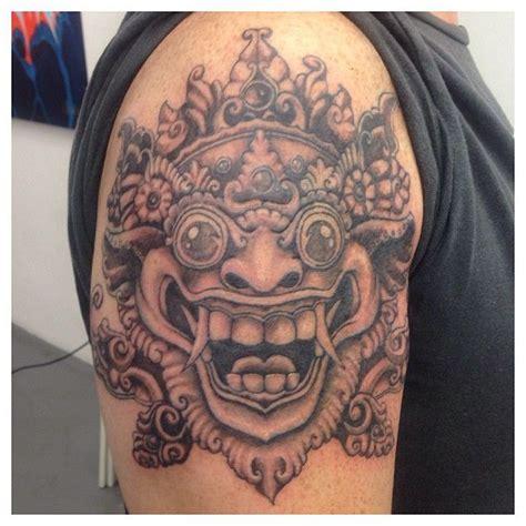indonesia arm tattoo indonesian barong mask blackandgrey tattoo ink