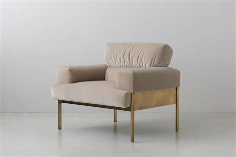 armchair design suki armchair armchairs from interiors inc architonic