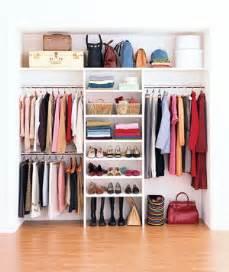 organizing handbags in closet